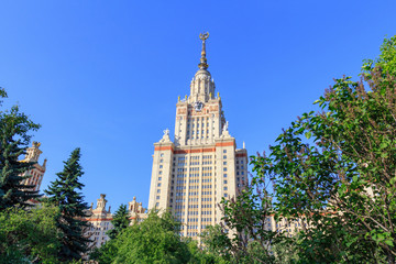 Moscow State University (MSU) in sunny summer evening on a green trees background
