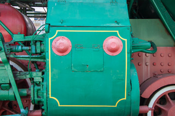green box with a handle of an old locomotive