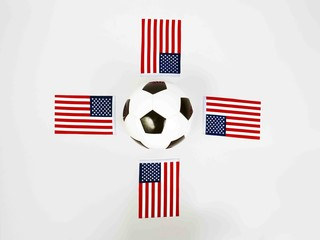vintage black and white football ball surrounded by national flags of united states of america