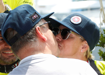 Prince Albert II of Monaco kisses his wife Princess Charlene after she won with her team the Riviera Water Bike Challenge in support of the Princess Charlene foundation in Monaco