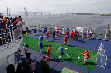 Players take part in a friendly soccer match on the Princess Anastasia cruise ferry in St. Petersburg