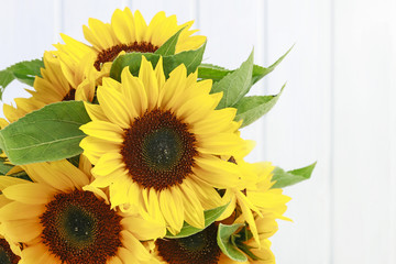 Wall Mural - Sunflowers on wooden background.