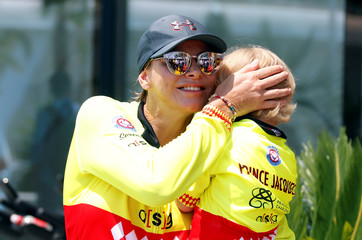 Princess Charlene of Monaco hugs her son Prince Jacques during the Riviera Water Bike Challenge in support of the Princess Charlene foundation in Monaco