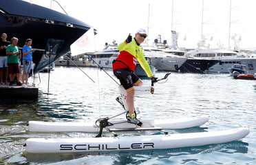Prince Albert II of Monaco takes the start of the Riviera Water Bike Challenge in the port of Monaco in support of the Princess Charlene foundation