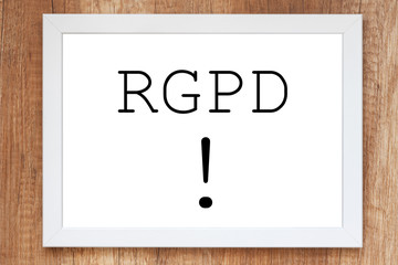 Wooden desk with a white frame with the word RGPD