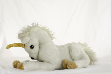 Unicorn horse doll on white background.