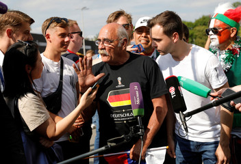 Soccer fan from Germany, Wirth, who arrived by his tractor to attend a match between Germany and Mexico during the FIFA 2018 World Cup, talks to the media in Moscow