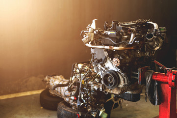 car engine repair in garage with soft-focus and over light in the background
