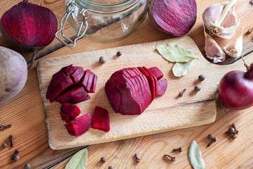 Sliced red beets with garlic and spices - ingredients to prepare beet kvass
