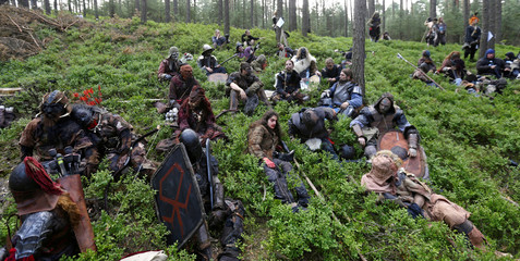 """Participants dressed as characters from J.R.R. Tolkien's novel """"The Hobbit"""" re-enact the """"Battle of Five Armies"""" in a forest near Doksy"""