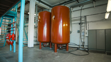 Boiler room and two red tank