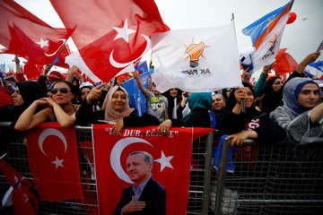 Supporters of Turkish President Tayyip Erdogan react during an election rally in Istanbul