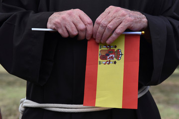 A missionary holds a Spanish flag as Spain's King Felipe and Queen Letizia visit the San Antonio Missions in San Antonio