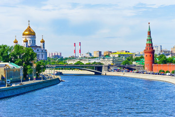 View of Kremlin and Cathedral of Christ the Saviour along the Moscow River in summer in Moscow, Russia.