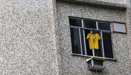 A Brazilian national soccer team jersey is seen in a window before the World Cup Group E soccer match between Brazil and Switzerland, in Rio de Janeiro
