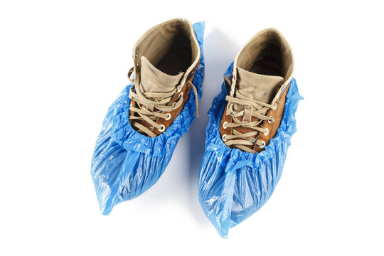 blue shoe covers on shoes