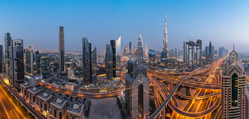 Dubai skyline during sunset with amazing city center lights and road traffic UAE.