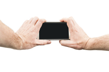Male hands holding smartphone for photographing, isolated on white background, first person view