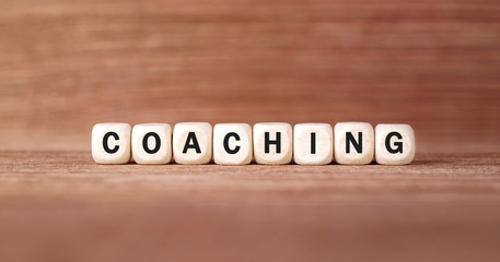 Word COACHING made with wood building blocks