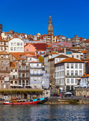 Colorful houses of Porto Ribeira, traditional facades, old multi-colored houses with red roof tiles on the embankment in the city of Porto, Portugal