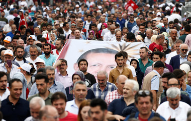 Supporters of Turkey's President Tayyip Erdogan walk through a campaign event in Istanbul