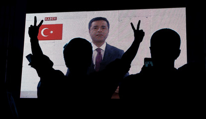 Supporters of Turkey's main pro-Kurdish Peoples' Democratic Party watch the jailed former leader and presidential candidate Selahattin Demirtas during campaign event in Istanbul