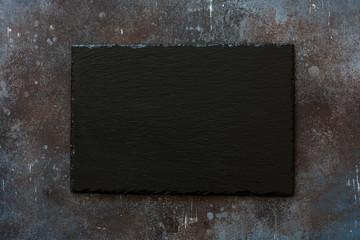 Black stone slate on grunge stone background