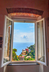 View on Portofino and sea from the window of castle Brown, Liguria, Italy