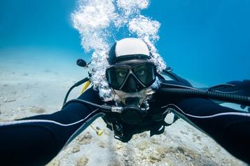 Scuba diver self portrait underwater