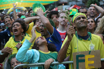 Fans react as they watch the broadcast of the FIFA World Cup Group E soccer match between Brazil and Switzerland, in Rio de Janeiro