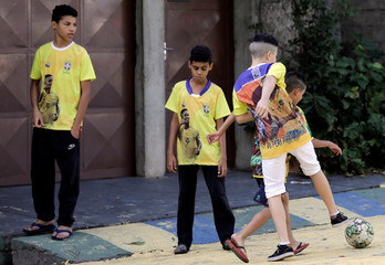 Children play soccer in the neighbourhood where Brazilian soccer player Gabriel Jesus lived in his childhood in Sao Paulo