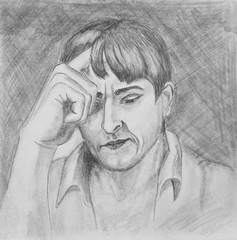 Portrait of a young man.The guy's holding his hand on his head.  Pencil drawing on paper
