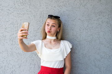 Funny blonde posing with smartphone