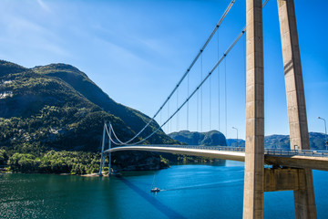 Typical Norwegian view of the bridge across the fjord. Colorful summer day in the Norway. Travel concept. Artistic picture. Beauty world