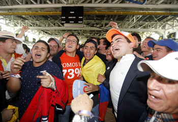 Followers of presidential candidate Duque celebrate as ballot counting begins during the second round of the presidential election in Bogota