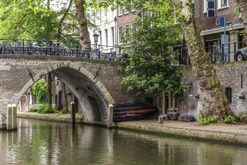 Old bridge with a boat in the center of Utrecht. netherlands