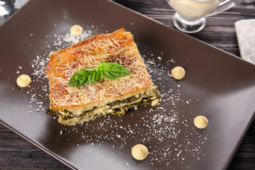 Lasagna with spinach on plate, close up