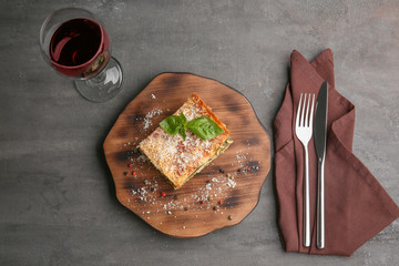 Lasagna with spinach on wooden board