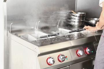 Pasta boiler in professional kitchen of restaurant