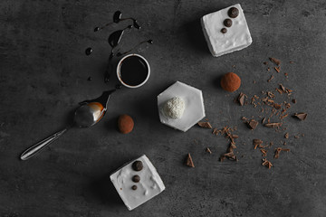 Composition with tasty souffle cakes on dark background