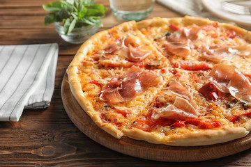 Delicious hot pizza with meat on table