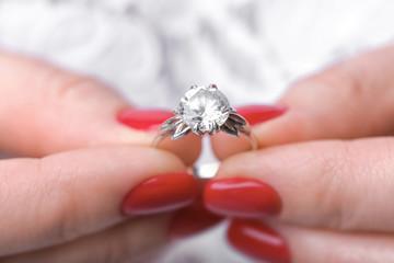 Woman holding beautiful engagement ring, closeup