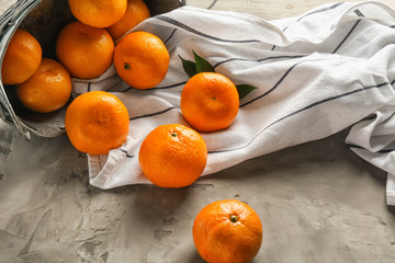 Juicy tangerines on table