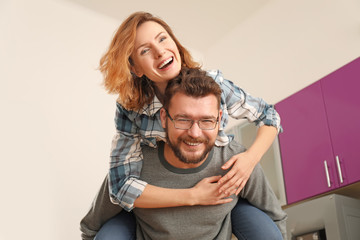 Lovely couple having fun together at home