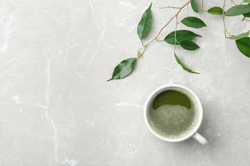 Flat lay composition with matcha tea and leaves on light background