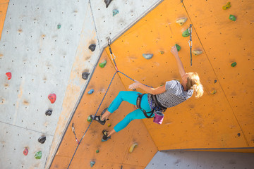 girl climbing up the wall