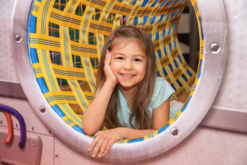 Cute girl playing in entertainment center