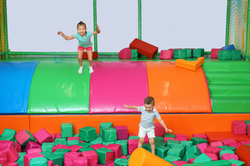 Cute children playing in entertainment center