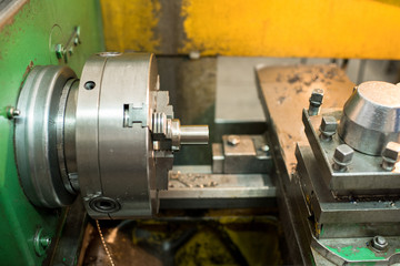 Close-up of steel milling lathe equipment for cutting metal detail at manufacturing plant