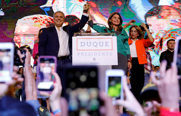 Presidential candidate Duque celebrates after winning the presidential election in Bogota